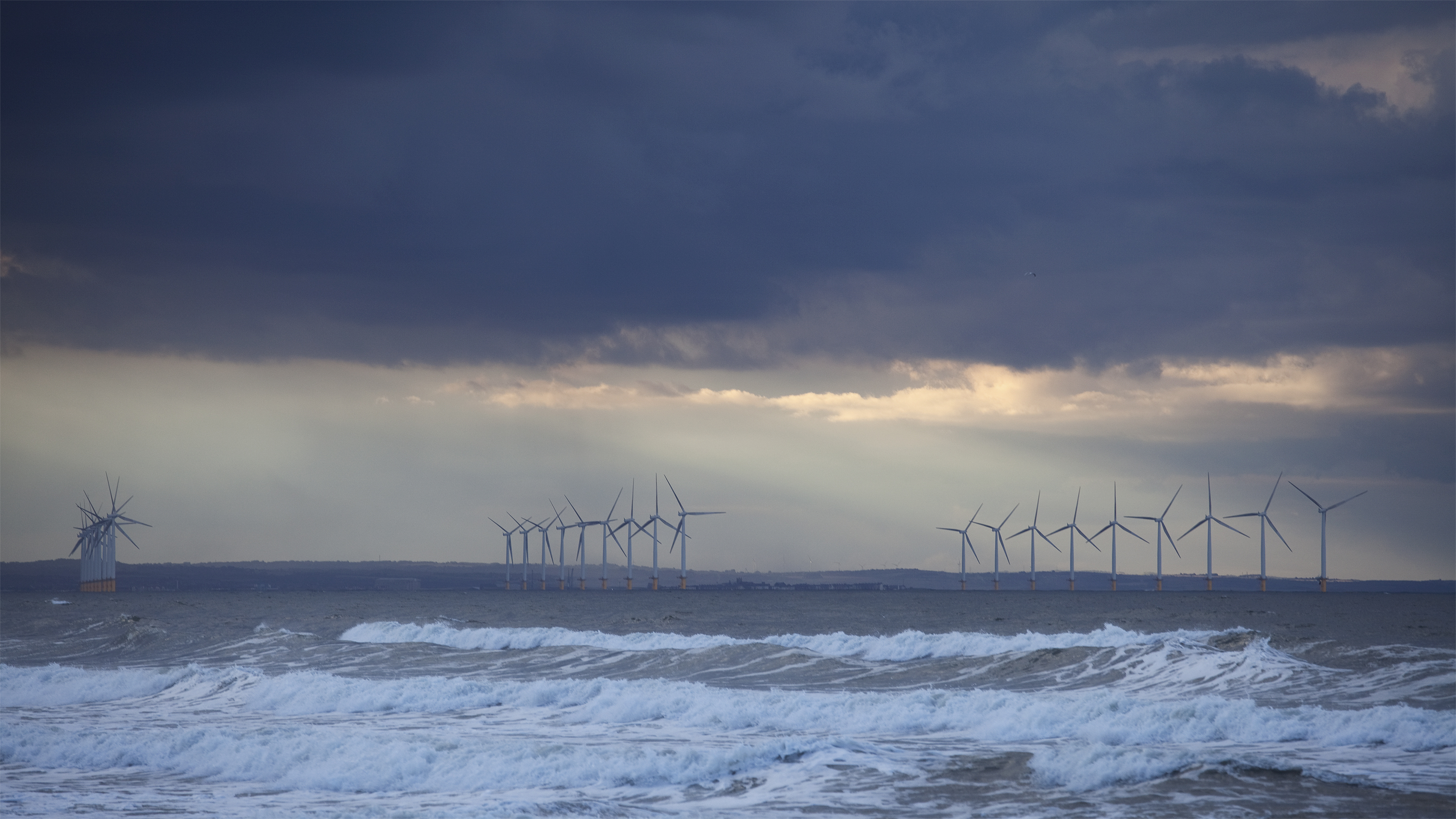windturbines england sea renewables storm
